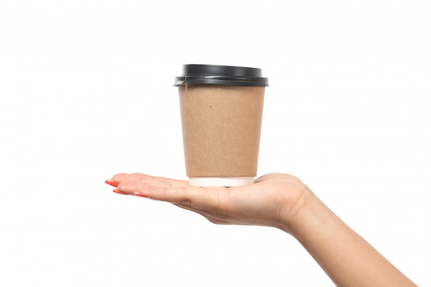A front view female hand holding coffee cup on white