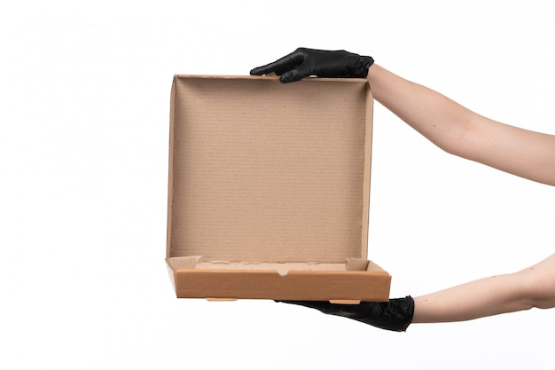 A front view female hand holding an empty delivery box on white
