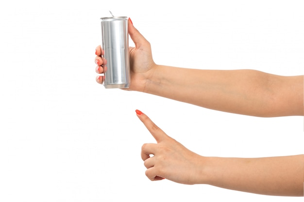 A front view female hand holding silver can showing finger on the white