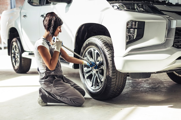Front view female mechanic repairing car