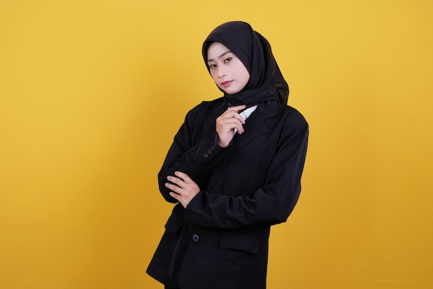 Front view of female office worker in black suit and black skirt thinking