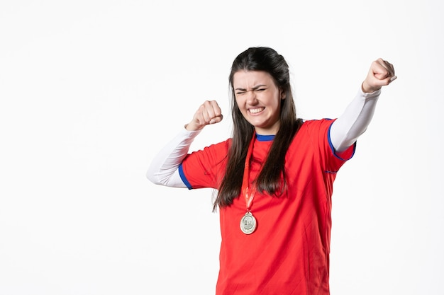 Front view female player in sport clothes with medal