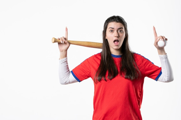 Front view female player with baseball bat has an idea