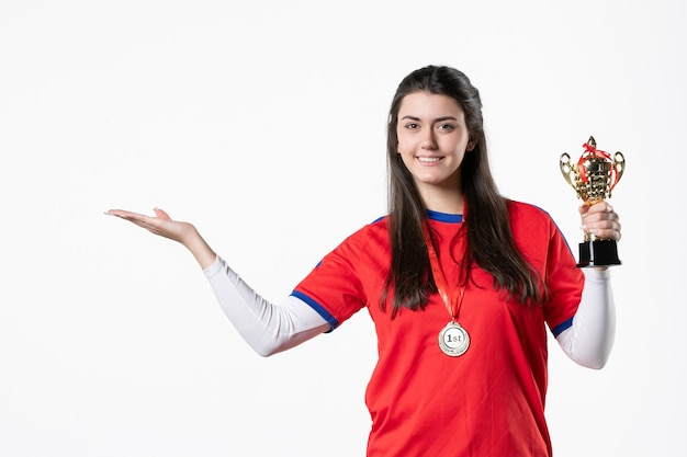 Front view female player with golden cup and medal