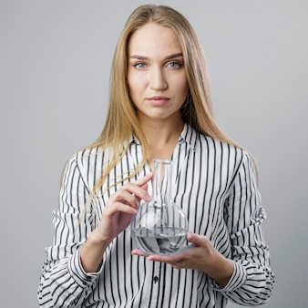 Front view of female scientist holding test tube