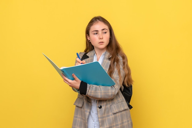 Front view of female student with files