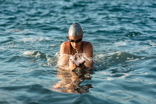Front view of female swimmer swimming in water