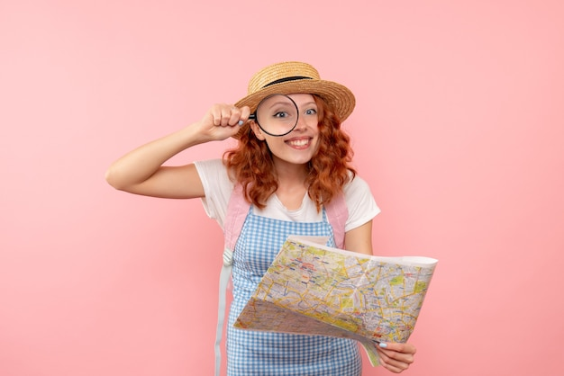 Front view female tourist exploring map trying to find direction in foreign city
