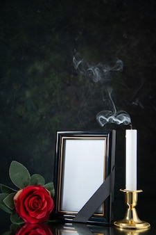 Front view of fireless candle with picture frame on black