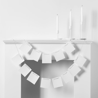 Front view of fireplace with candles for hanukkah and paper garland