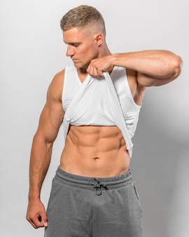 Front view of fit man showing abs