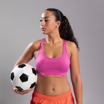 Front view fit woman holding ball