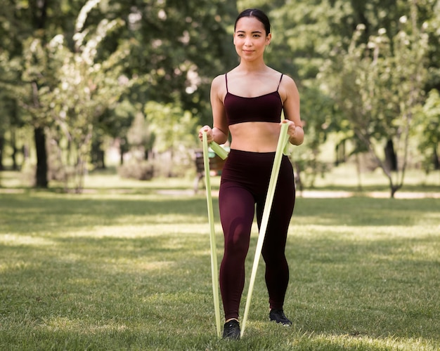 Front view fit woman training outdoors