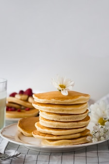 Front view fluffy pancakes tower