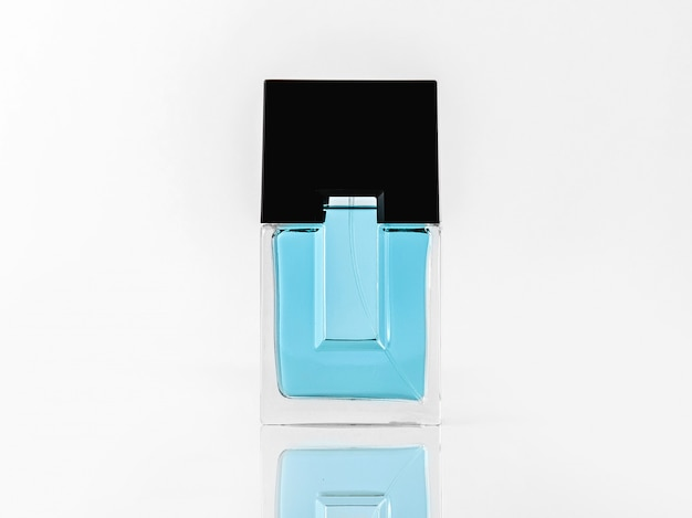 A front view fragrance in blue and black designed bottle on the white wall
