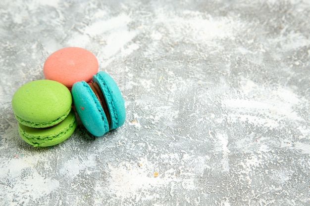Front view french macarons colorful cakes on the white surface cake pie bake biscuit sweet cookie