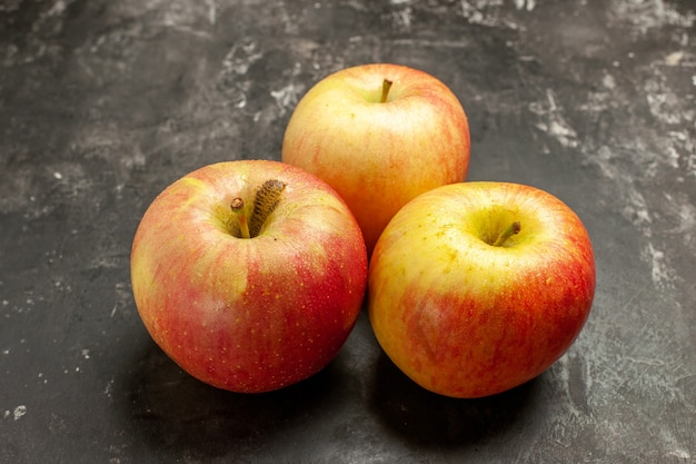 Front view fresh apples on dark fruits ripe vitamine tree mellow juice photo color