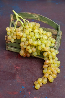 Front view fresh grapes green and ripe fruits on a dark surface wine grape fruit ripe fresh tree plant