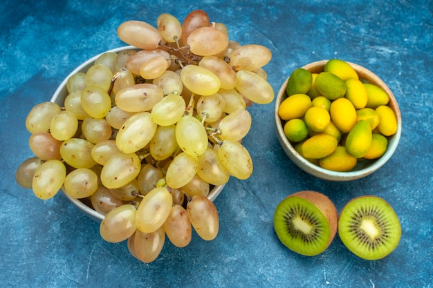 Front view fresh grapes inside plate on blue juice ripe color fruit mellow photo