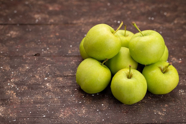 Front view fresh green apples isolated on wooden desk