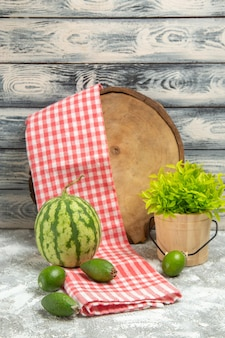 Front view fresh green feijoa with watermelon on grey background fruit mellow color green