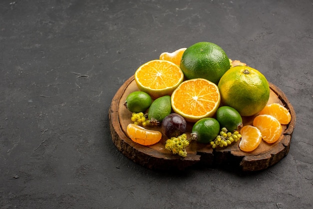 Front view fresh green tangerines with feijoas on dark space