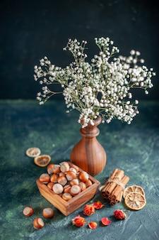 Front view fresh hazelnuts on the dark-blue shell nut cips photo snack walnut peanut color