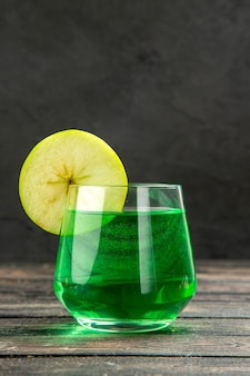 Front view of fresh natural delicious juice in a glass on black background