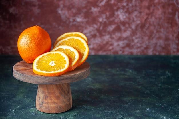 Front view fresh oranges on dark background fruit citrus color mellow citrus ripe juice tree taste free space