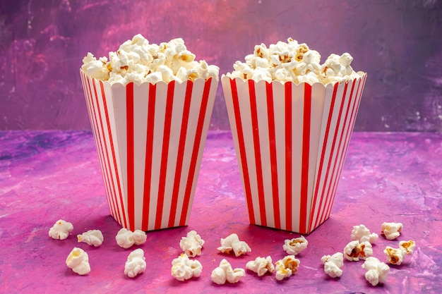 Front view fresh popcorn on light pink table color cinema movie