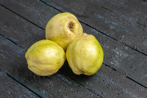 Front view fresh quinces mellow and sour fruits on dark-blue desk ripe fetus fresh tree sour plant fruit