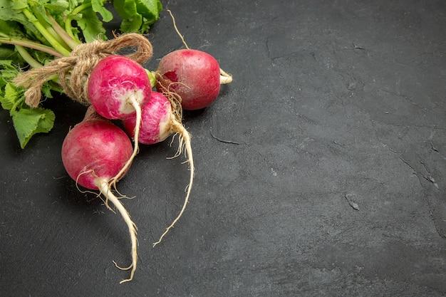 Front view fresh radish with greens on dark table ripe salad
