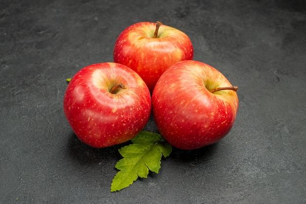Front view fresh red apples on a grey background ripe photo color tree fruit juice vitamine