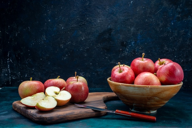 Front view fresh red apples juicy and mellow inside plate on the dark blue desk fruit fresh ripe mellow