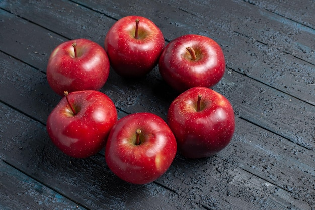Front view fresh red apples mellow and ripe fruits on dark-blue desk fruit whole color red plant vitamine fresh