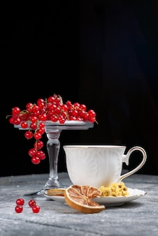 Front view fresh red cranberries with cup of coffee on the light desk fruit berry coffee lemon
