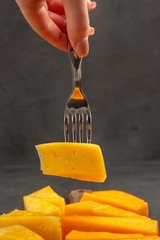 Front view fresh sliced cheese on fork dark photo breakfast crisp meal snack