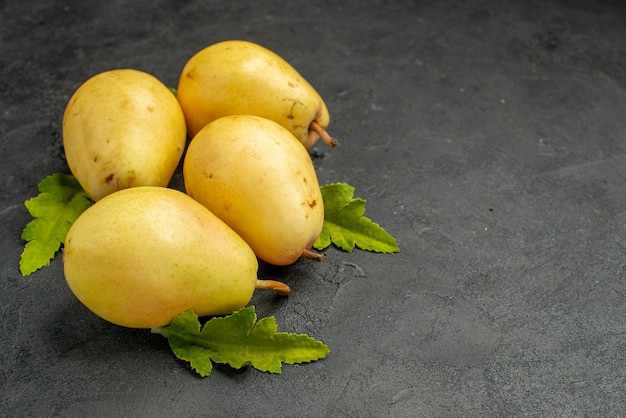 Front view fresh sweet pears on grey background fruit color ripe pulp  tree