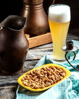 Front view fried dyushbara azerbaijani traditional dish with a glass of beer