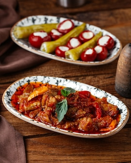 A front view fried meat with vegetables and tomatoe sauce on the brown wooden desk food meal meat