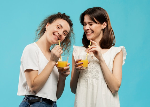 Front view of friends drinking juice