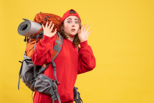 Front view frightened traveller woman in red backpack
