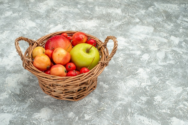 Front view fruit composition different fresh fruits inside basket on a white space