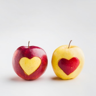 Front view of fruit heart shapes on apples