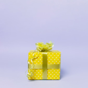 Front view of gift box with ribbon and copy space
