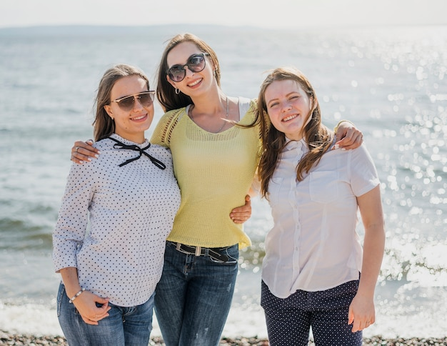 Front view girl friends at the seaside