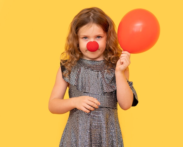 Front view girl holding red balloon