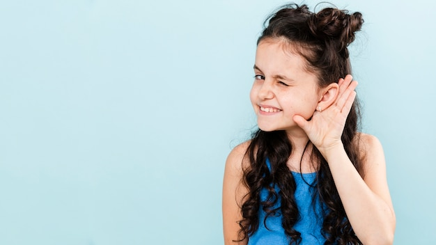 Front view girl picking with ear pose