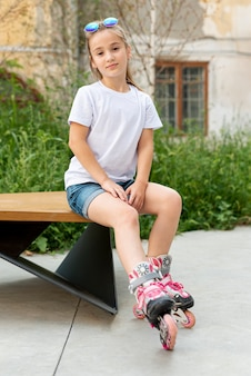 Front view of girl sitting on bench