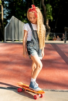 Front view of girl on skateboard